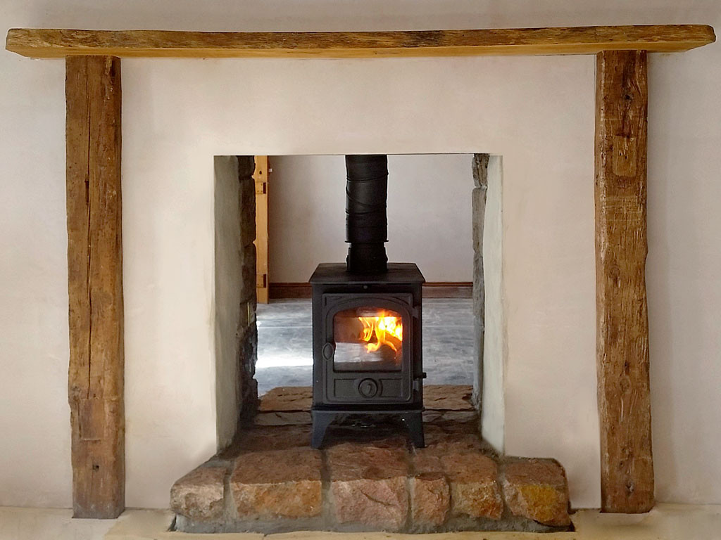 double sided hunter stove in new build jersey granite fireplace
