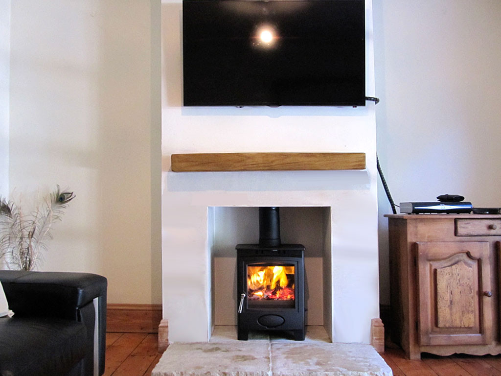 multi fuel stove makes a stunning feature in the inglenook
